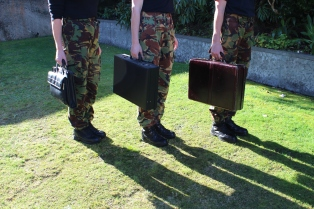 3 TorquePoint camo women with briefcases ready for the next business simulation - Black Swans